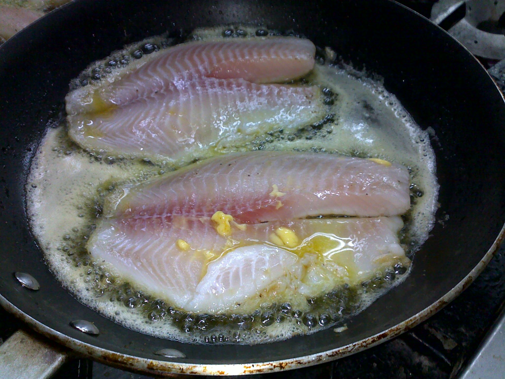 How to cook fish on stovetop or oven the culinary cook for Fish fry oil temp